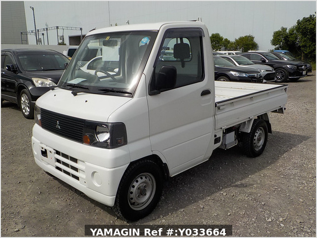 It is a picture of the white mitsubishi minicab  truck in 2002,Sub Photo 1 Stock No.Y033664