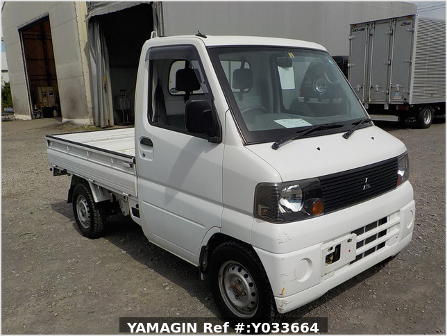 It is a picture of the white mitsubishi minicab  truck in 2002,Sub Photo 0 Stock No.Y033664