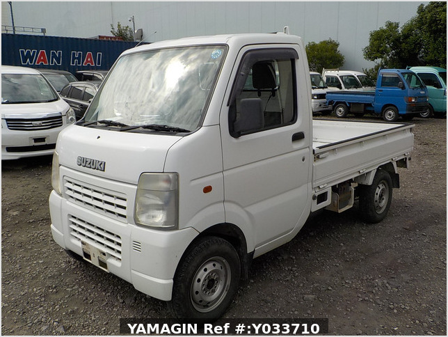 It is a picture of the white suzuki carry truck in 2002,Sub Photo 1 Stock No.Y033710
