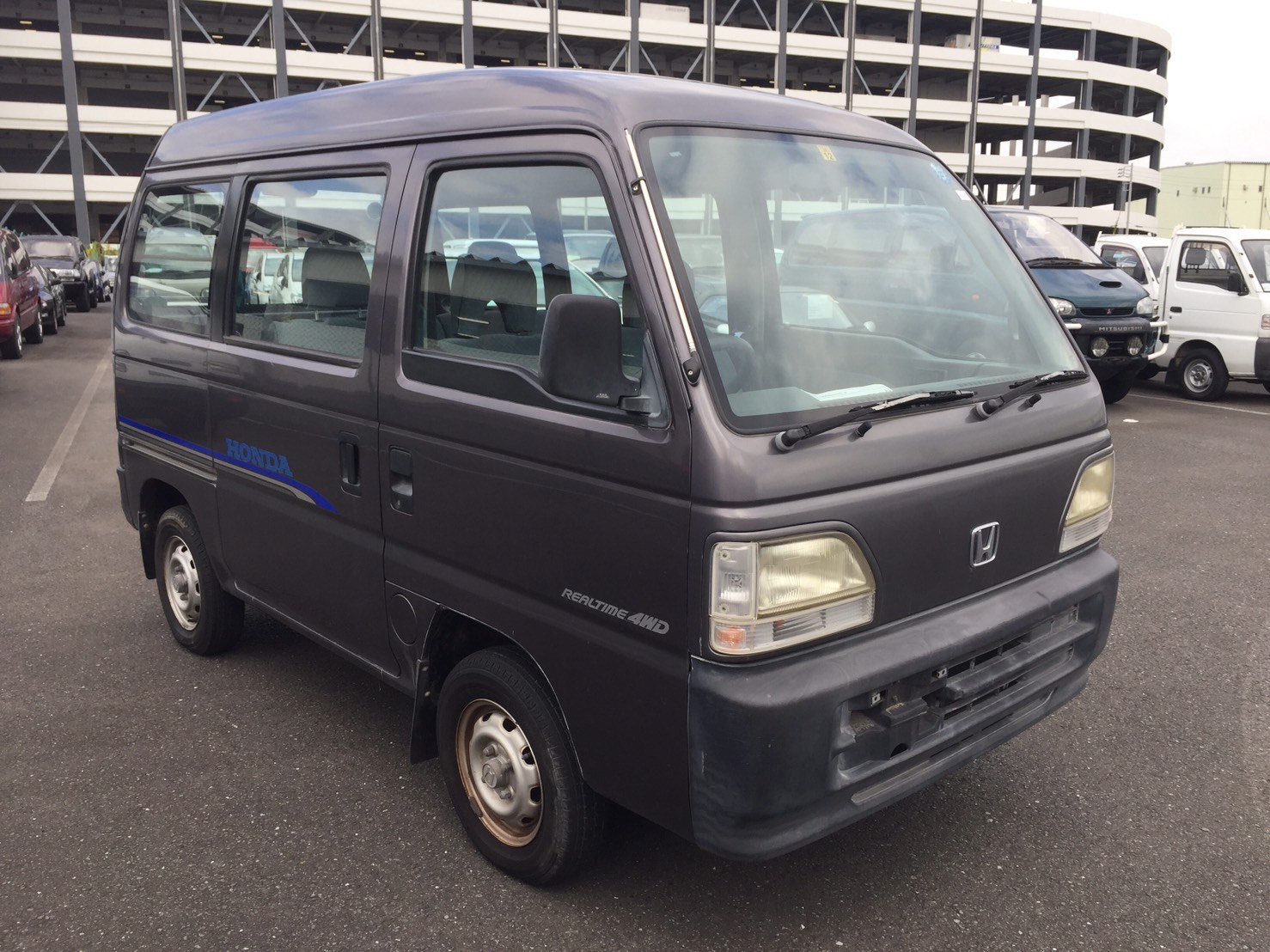 It is a picture of the gray m honda acty passenger van in 1996,First Photo Stock No.Y033730