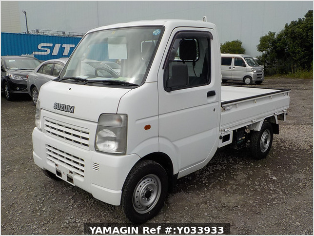 It is a picture of the white suzuki carry truck in 2004,Sub Photo 1 Stock No.Y033933