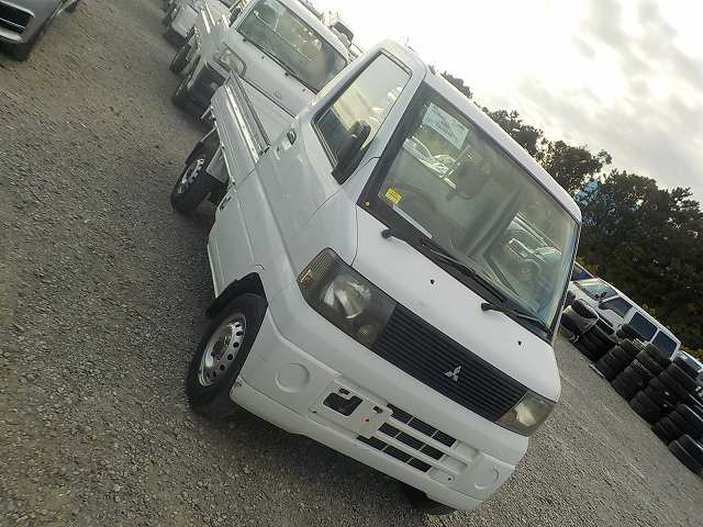 It is a picture of the white mitsubishi minicab truck in 2001,First Photo Stock No.Y034116