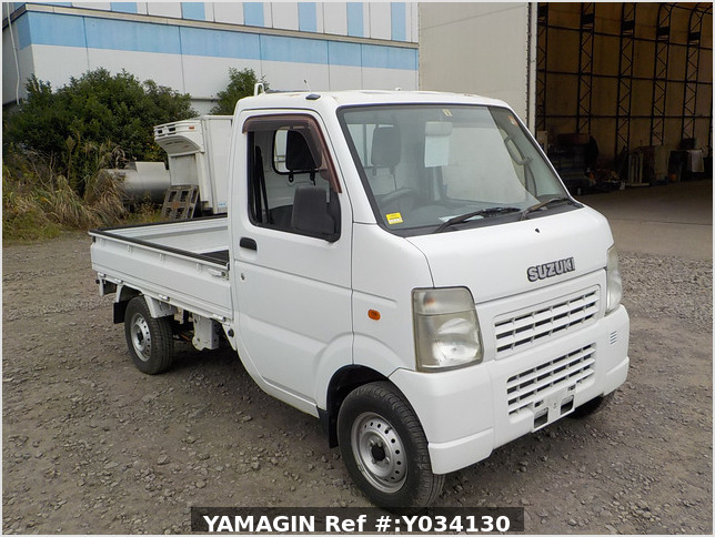 It is a picture of the white suzuki carry truck in 2009,Sub Photo 0 Stock No.Y034130