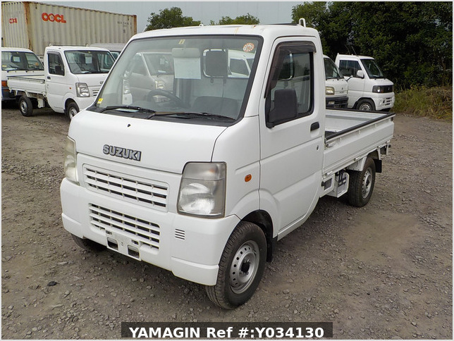 It is a picture of the white suzuki carry truck in 2009,Sub Photo 1 Stock No.Y034130