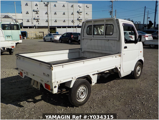 It is a picture of the white suzuki carry truck in 2003,Sub Photo 2 Stock No.Y034315