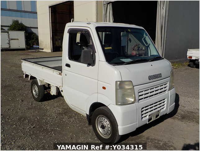 It is a picture of the white suzuki carry truck in 2003,Sub Photo 0 Stock No.Y034315
