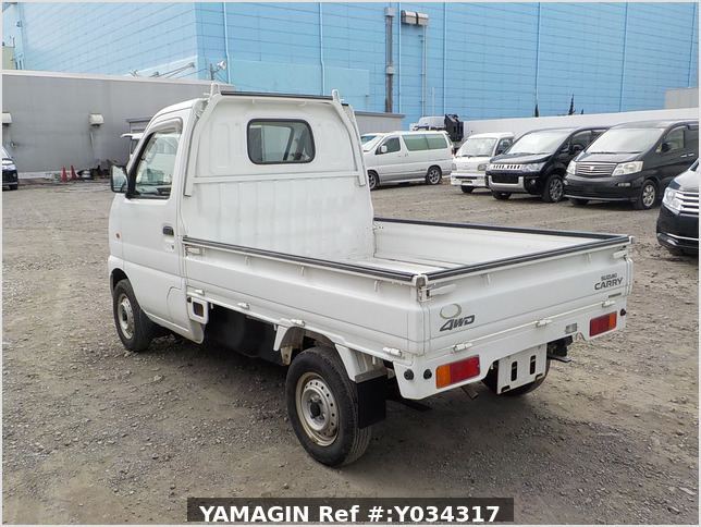 It is a picture of the white suzuki carry truck in 2002,Sub Photo 3 Stock No.Y034317
