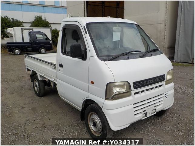 It is a picture of the white suzuki carry truck in 2002,Sub Photo 0 Stock No.Y034317