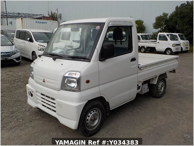 It is a picture of the white mitsubishi minicab truck in 1999,Sub Photo 1 Stock No.Y034383