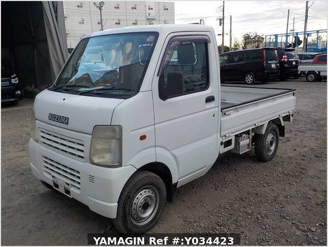 It is a picture of the white suzuki carry truck in 2003,Sub Photo 1 Stock No.Y034423