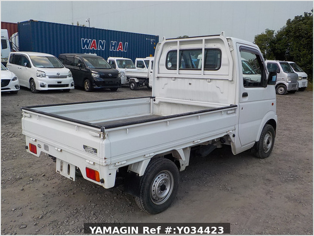 It is a picture of the white suzuki carry truck in 2003,Sub Photo 2 Stock No.Y034423