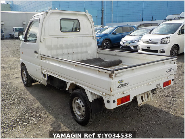 It is a picture of the white suzuki carry truck in 2002,Sub Photo 2 Stock No.Y034538