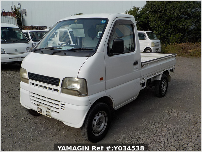 It is a picture of the white suzuki carry truck in 2002,Sub Photo 1 Stock No.Y034538
