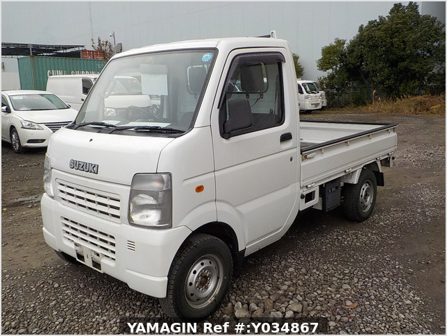 It is a picture of the white suzuki carry truck in 2006,Sub Photo 1 Stock No.Y034867