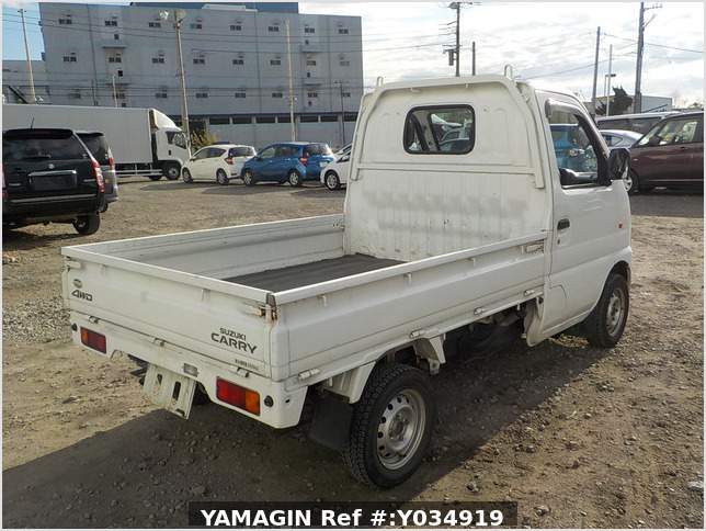 It is a picture of the white suzuki carry truck in 2001,Sub Photo 2 Stock No.Y034919