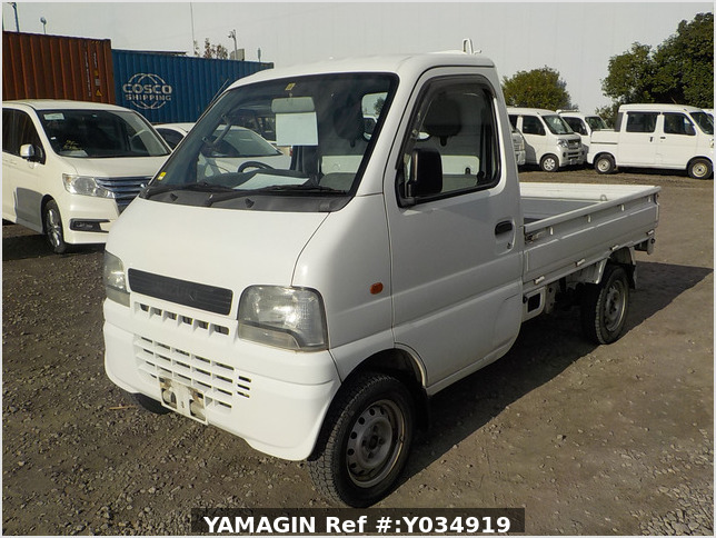 It is a picture of the white suzuki carry truck in 2001,Sub Photo 1 Stock No.Y034919