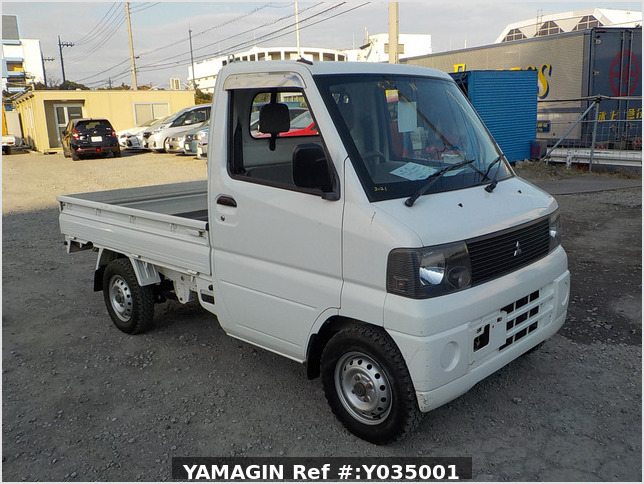 It is a picture of the white mitsubishi minicab  truck in 2001,Sub Photo 0 Stock No.Y035001