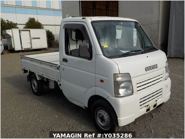 It is a picture of the white suzuki carry truck in 2005,Sub Photo 0 Stock No.Y035286
