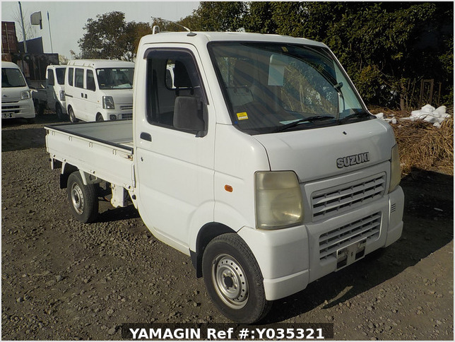 It is a picture of the white suzuki carry truck in 2002,Sub Photo 0 Stock No.Y035321