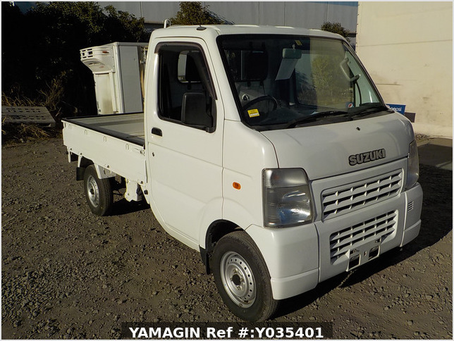 It is a picture of the white suzuki carry truck in 2006,Sub Photo 0 Stock No.Y035401