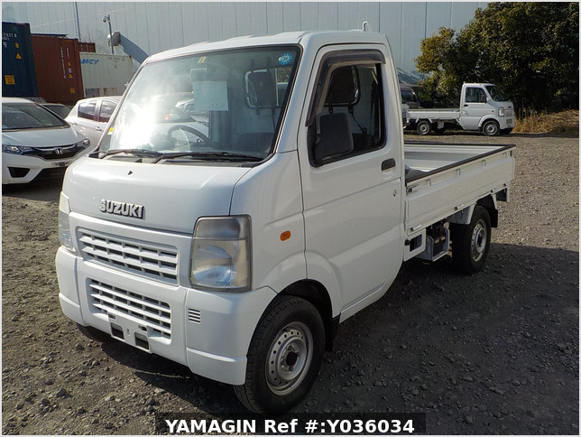 It is a picture of the white suzuki carry truck in 2006,Sub Photo 1 Stock No.Y036034