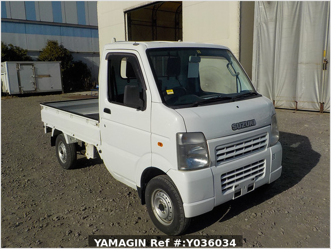It is a picture of the white suzuki carry truck in 2006,Sub Photo 0 Stock No.Y036034