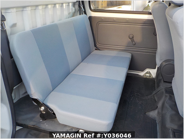 It is a picture of the white daihatsu hijet deck van in 2009,Sub Photo 13 Stock No.Y036046