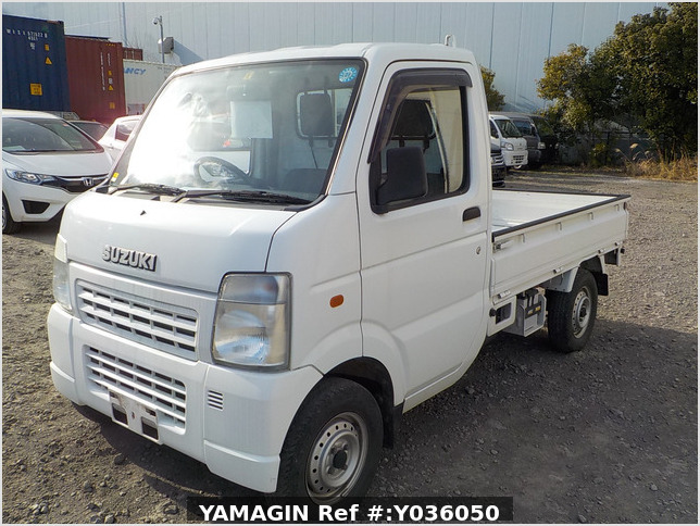 It is a picture of the white suzuki carry truck in 2004,Sub Photo 1 Stock No.Y036050