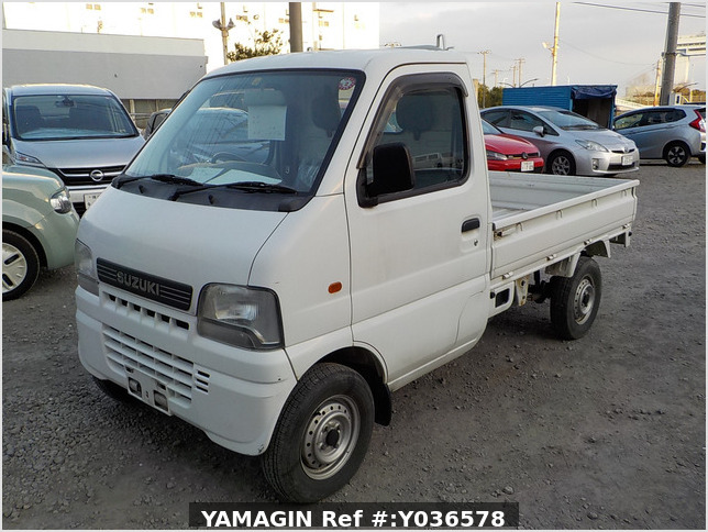 It is a picture of the white suzuki carry truck in 2001,Sub Photo 1 Stock No.Y036578