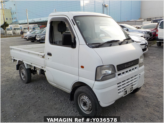 It is a picture of the white suzuki carry truck in 2001,Sub Photo 0 Stock No.Y036578
