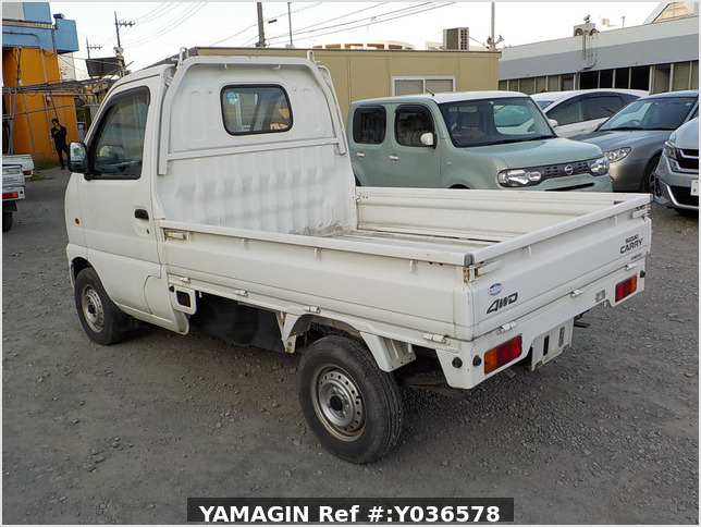 It is a picture of the white suzuki carry truck in 2001,Sub Photo 3 Stock No.Y036578