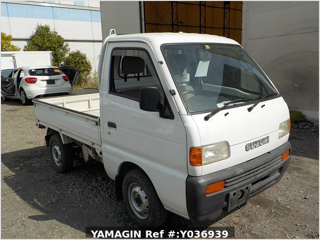 It is a picture of the white suzuki carry truck in 1996,Sub Photo 0 Stock No.Y036939