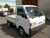 It is a picture of the white suzuki carry truck in 1996,First Photo Stock No.Y036939