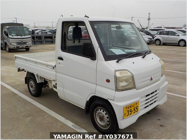 It is a picture of the white mitsubishi minicab truck in 1999,Sub Photo 0 Stock No.Y037671