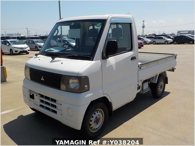 It is a picture of the white mitsubishi minicab  truck in 2001,Sub Photo 1 Stock No.Y038204
