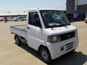It is a picture of the white mitsubishi minicab  truck in 2001,First Photo Stock No.Y038204