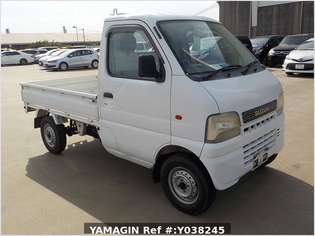 It is a picture of the white suzuki carry truck in 2001,Sub Photo 0 Stock No.Y038245