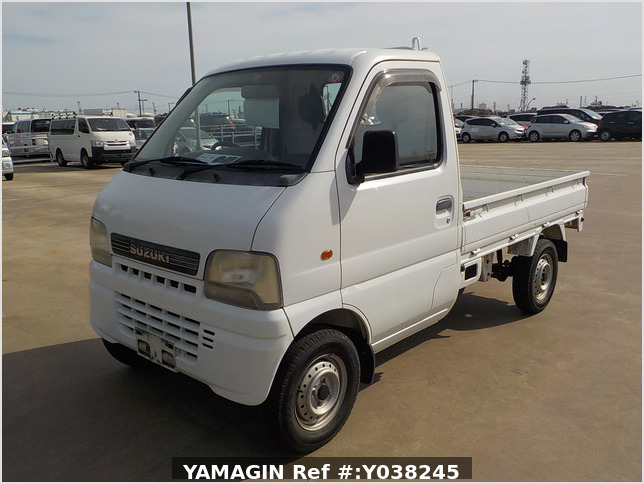 It is a picture of the white suzuki carry truck in 2001,Sub Photo 1 Stock No.Y038245