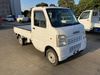 It is a picture of the white suzuki carry truck in 2006,Sub Photo 0 Stock No.Y040098