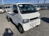 It is a picture of the white suzuki carry truck in 2001,Sub Photo 0 Stock No.Y040313