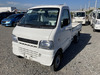 It is a picture of the white suzuki carry truck in 2001,Sub Photo 1 Stock No.Y040313